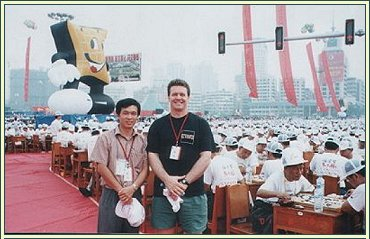 Mick Reiss at the 2001 Guiyang Go Festival, China. There are 4,000 people behind him, all playing Go!