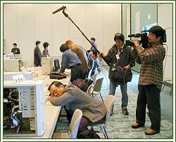 The author of Amano Shogi catches up on some sleep at the 1999 World Computer Shogi Championship in Tokyo